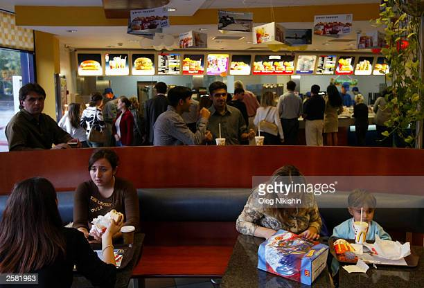 Customers eat in a McDonald's restaurant October 11 2003 in Baku Azerbaijan Many Western companies continue to open businesses in Azerbaijan