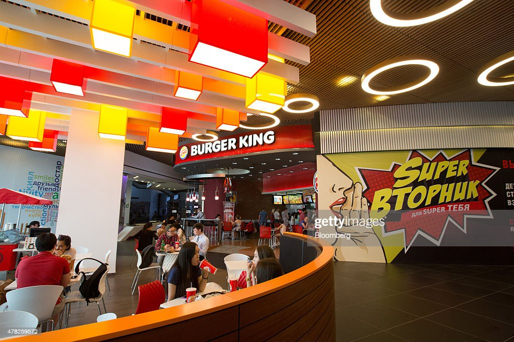 Customers eat in the restaurant area of a Burger King Corp. fast food outlet at the Esentai luxury shopping mall in Almaty, Kazakhstan, on Tuesday, June 23, 2015. Kazakhstan completed its negotiations to become the 162nd member of the World Trade Organization, after 19 years of negotiations, and hopes to fully ratify its accession by Oct. 31. Photographer: Andrey Rudakov/Bloomberg via Getty Images