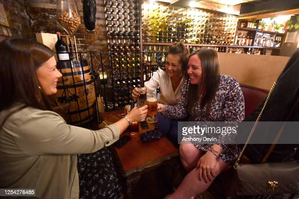 Customers enjoy drinks at the Vicolo del Vino Wine Bar on July 04 2020 in Rochdale England The UK Government announced that Pubs Hotels and...
