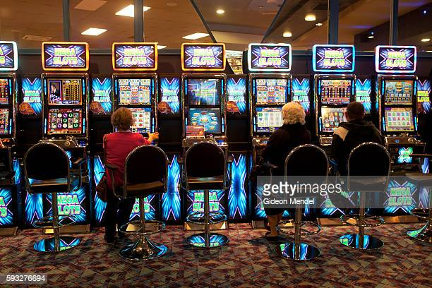 Customers enjoy playing on the fruit machines at the Gala Bingo Hall in Stratford close to the site of the 2012 Olympic Games This venue is part of...