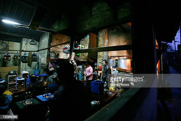 Customers enjoy tea with their bird cages put aside at a Laohuzao teahouse at an alleyway January 23, 2007 in Shanghai, China. Laohuzao is a...