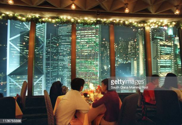 Customers enjoy the night scene while they have their final buffet in the infamous revolving restaurant La Ronda at the 28yearold Furama Hotel which...