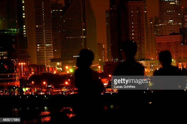 Customers enjoy the view to Shanghai's Pudong Skyline from Bar Rouge's terrace on May 9 2008 in Shanghai China