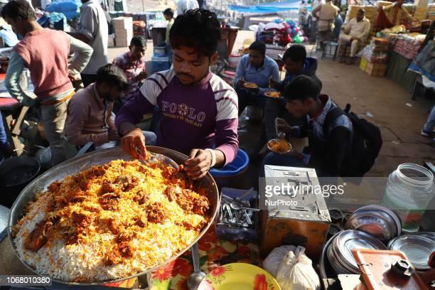 Customers enjoying Chicken Biryani outside Jama Masjid in the Old Quarters of Delhi