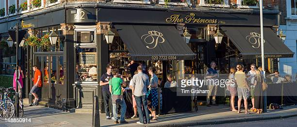 Customers enjoying warm weather at The Princess traditional London pub in Primrose Hill London