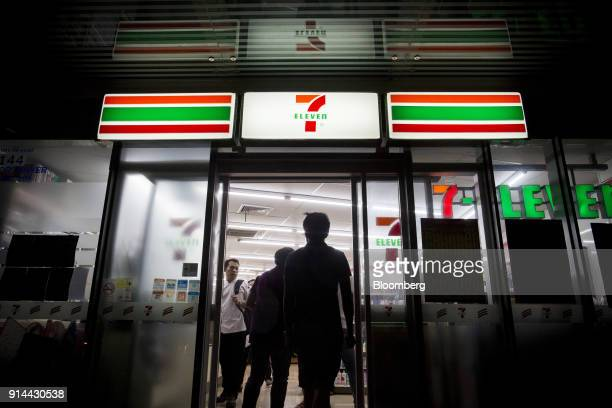 Customers enter a 7eleven convenience store operated by Seven i Holdings Co in Bangkok Thailand on Saturday Jan 27 2018 Thai consumer confidence...