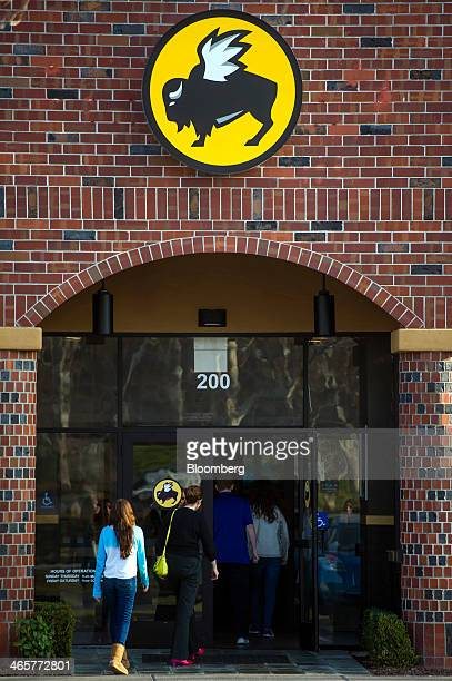 Customers enter a Buffalo Wild Wings Inc restaurant in San Ramon California US on Thursday Jan 23 2014 Buffalo Wild Wings Inc is expected to release...
