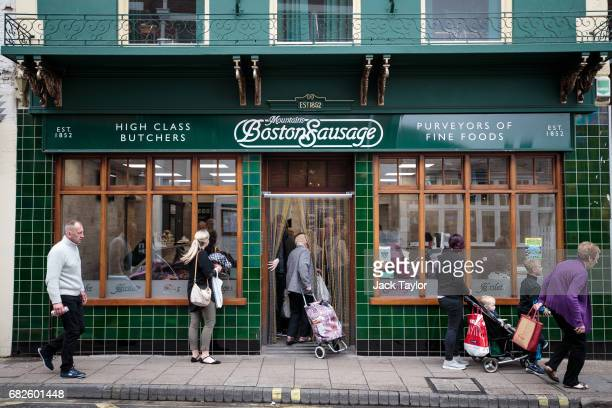 Customers enter a butchers called 'Boston Sausage' on May 13 2017 in Boston United Kingdom The town of Boston in Lincolnshire voted with a 75%...