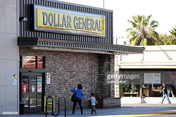 Customers enter a Dollar General store on March 12 2015 in Vallejo California Dollar General Stores Inc announced plans to open over 700 new stores...