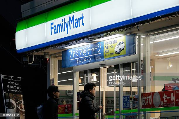 Customers enter a FamilyMart Co convenience store in Tokyo Japan on Saturday March 7 2015 FamilyMart and Uny Group Holdings Co are in merger talks to...