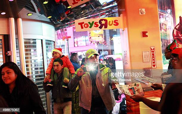 Customers enter a Toys R Us in Times Square on Thanksgiving evening for early Black Friday sales on November 26 2015 in New York City Security has...