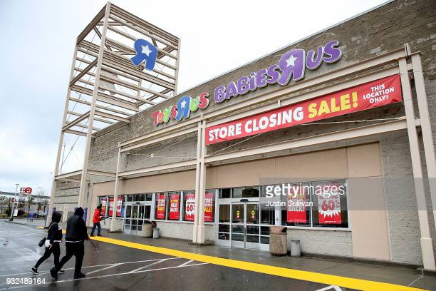 Customers enter a Toys R Us store on March 15 2018 in Emeryville California Toys R Us filed for liquidation in a US Bankruptcy court and plans to...
