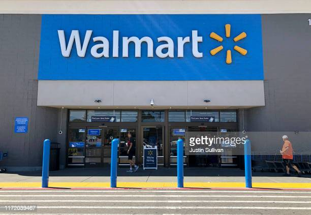 Customers enter a Walmart store on September 03, 2019 in San Leandro, California. Walmart, America's largest retailer, announced that it will reduce...