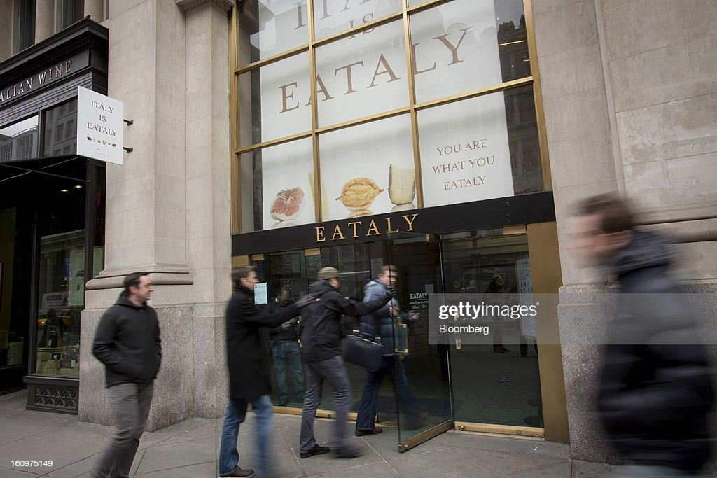 Customers enter an Eataly location in the Flatiron district of New York, U.S., on Wednesday, Feb. 6, 2013. Eataly is a high-end Italian food market/mall chain, owned by a partnership including Mario Batali, Lidia Bastianich and Joe Bastianich, which first opened in Turin, Italy, in 2007. Photographer: Scott Eells/Bloomberg via Getty Images