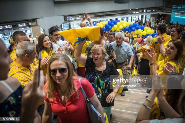 Customers enter an Ikea AB store carrying shopping bags during the opening of the company's store in Belgrade Serbia on August 10 2017 / AFP PHOTO /...