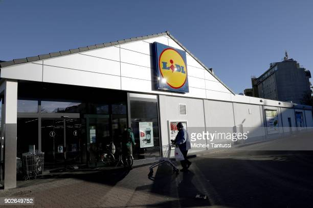 Customers enter an LiDL Discount supermarket on January 8 2018 in Berlin Germany According to government statisticians nominal revenue grew compared...