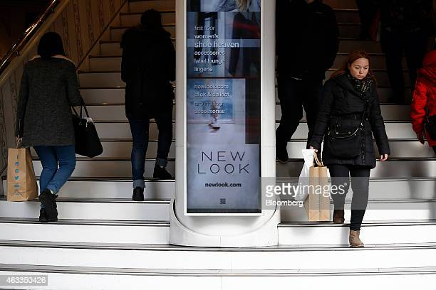 Customers enter and exit a New Look fashion store operated by New Look Group Ltd on Oxford Street in London UK on Friday Feb 13 2015 Apax Partners...
