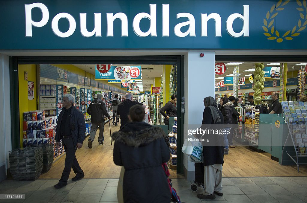 Customers enter and exit a Poundland discount store, operated by Poundland Group Plc in London, U.K., on Friday, March 7, 2014. Poundland Group Plc has demand for all the shares it is selling in an initial public offering that will value the U.K. discount retailer at as much as 750 million pounds ($1.3 billion), according to terms of the deal. Photographer: Simon Dawson/Bloomberg via Getty Images