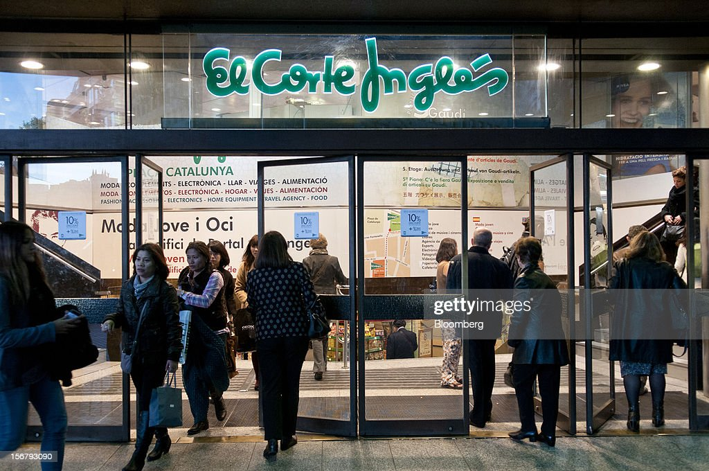 Customers enter and exit an El Corte Ingles department store in Barcelona, Spain, on Tuesday, Nov. 20, 2012. Bank of Spain Governor Luis Maria Linde said the government risks missing its budget targets this year and next, adding to doubts on Prime Minister Mariano Rajoy's ability to cut the deficit amid a five-year slump. Photographer: Stefano Buonamici/Bloomberg via Getty Images