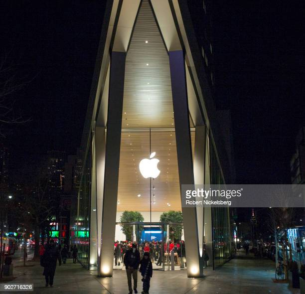 Customers enter and leave the new Apple Store near the Barclay Center December 29 2017 in the Brooklyn borough of New York City The Fort Greene store...