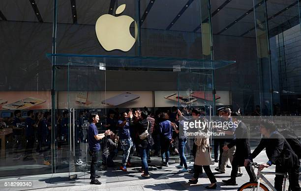 Customers enter Apple Inc's Omotesando store on March 31 2016 in Tokyo Japan Apple Inc launched its iPhone SE and iPad Pro 97 inch on March 31 2016...
