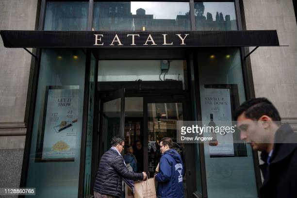 Customers enter Eataly, a 50,000 square-foot emporium devoted to the food and culinary traditions of Italy, in the Flatiron District, March 6, 2019...