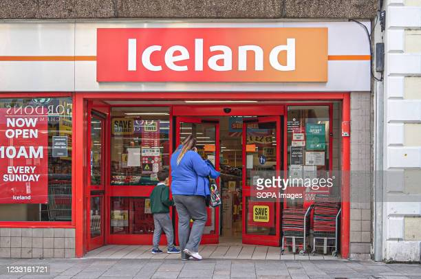 Customers enter Iceland Frozen Food Store on Bow St.