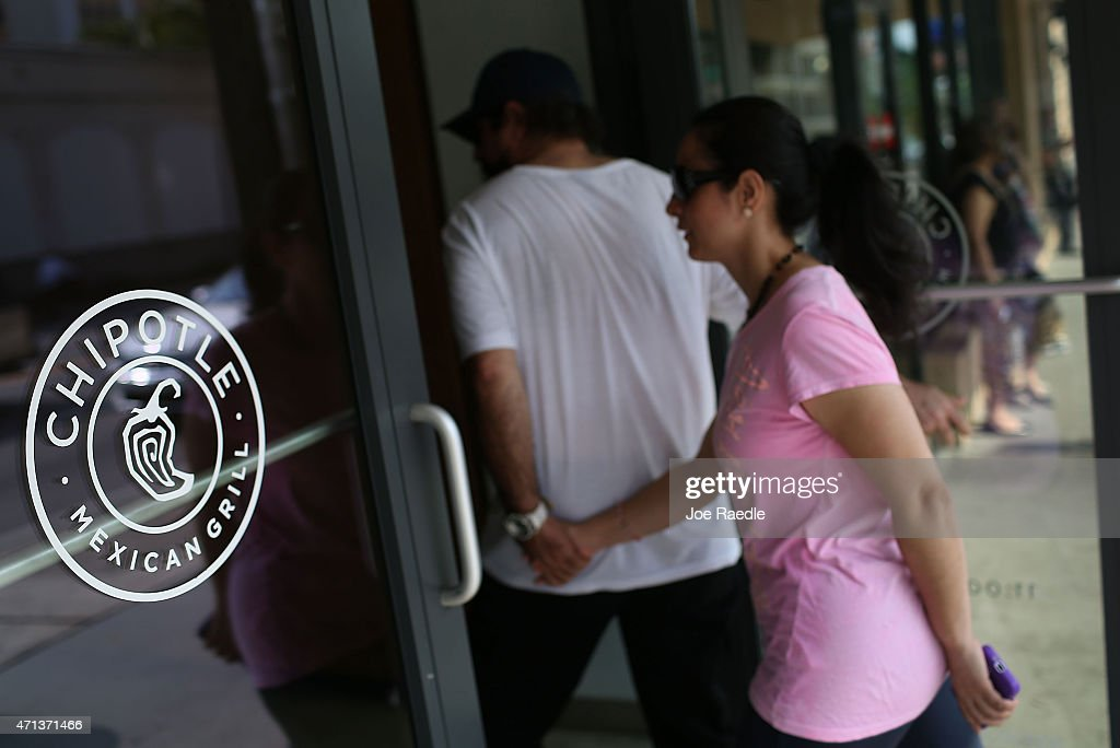 Customers enter the Chipotle restaurant, on the day that the company announced it will only use non-GMO ingredients in its food on April 27, 2015 in Miami, Florida. The company announced, that the Denver-based chain would not use the GMO's, which is an organism whose genome has been altered via genetic engineering in the food served at Chipotle Mexican Grills.