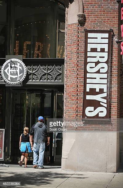 Customers enter the Hershey's Chocolate World store on July 16 2014 in Chicago Illinois The store located along the Magnificent Mile sells Hershey...