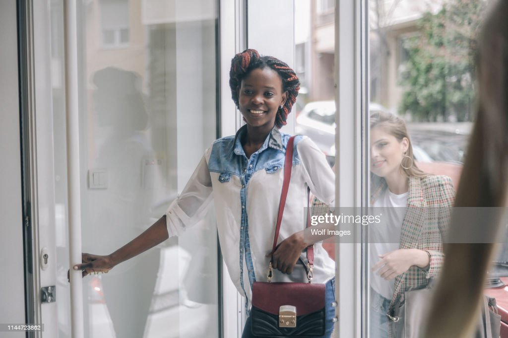 Customers entering the retail store : Stock Photo