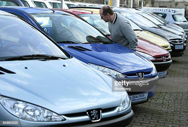 A customers examines a Peugeot car at a dealership in Wiesbaden Germany Tuesday February 10 2004 Western European car sales fell in October for a...