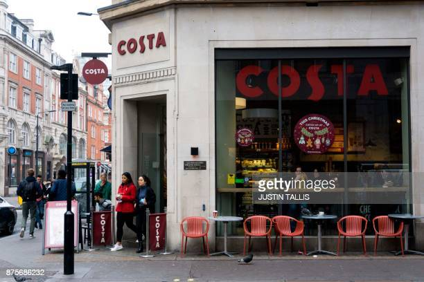 Customers exit a branch of a Costa coffee shop in London on November 15 2017 / AFP PHOTO / Justin TALLIS