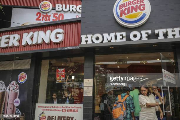 Customers exit a Burger King Corp fast food restaurant in Mumbai India on Friday Dec 15 2017 India's inflation surged past the central bank's target...