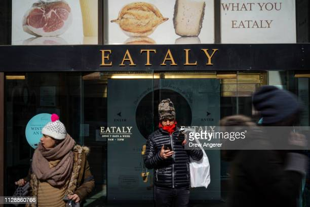 Customers exit Eataly, a 50,000 square-foot emporium devoted to the food and culinary traditions of Italy, in the Flatiron District, March 6, 2019 in...