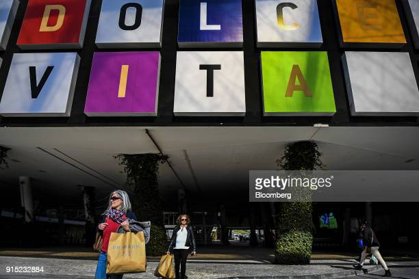 Customers exit the Dolce Vita Tejo shopping mall operated by AXA Real Estate Investment Managers SGR SpA with their Primark Stores Ltd shopping bags...