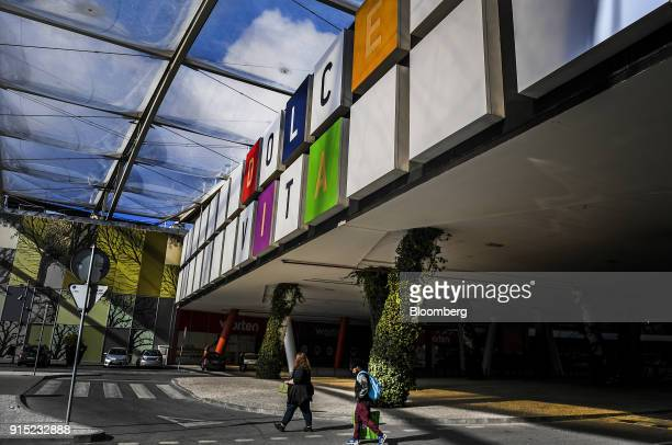 Customers exit the Dolce Vita Tejo shopping mall operated by AXA Real Estate Investment Managers SGR SpA in Lisbon Portugal on Friday Feb 2 2018 As...