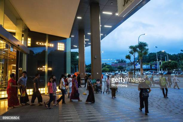Customers exit the Junction City mall in Yangon Myanmar on Friday June 16 2017 A pariah state for decades Myanmars recent emergence from economic...