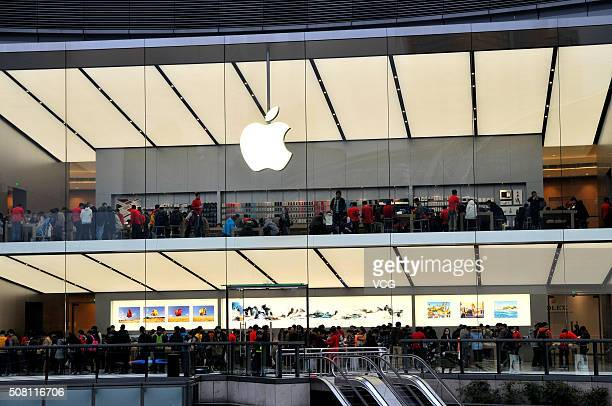 Customers experience Apple products at an newopened Apple Store in Tianhe District on February 2 2016 in Guangzhou Guangdong Province of China...