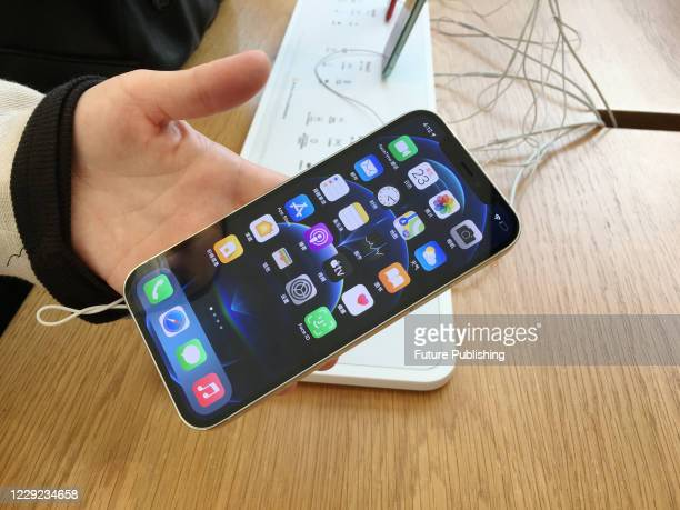Customers experience the new iPhone 12 in Apple's flagship store in West Lake. Hangzhou, Zhejiang Province, China, October 23, 2020.- PHOTOGRAPH BY...