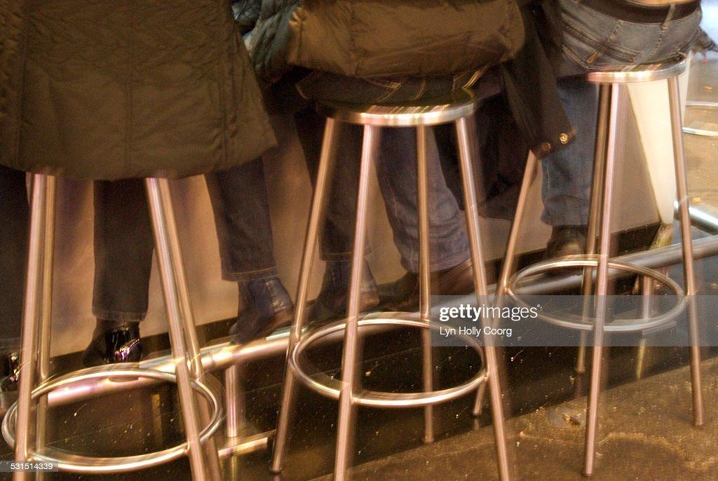 Customers feet at bar in Mercado de La Boqueria : Stock Photo