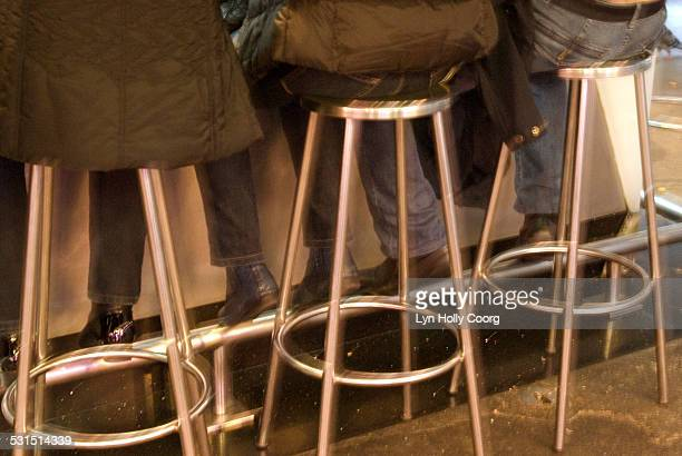 customers feet at bar in mercado de la boqueria - lyn holly coorg stock photos and pictures