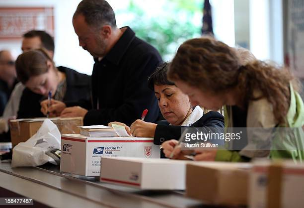 Customers fill in address information on packages at the United States Post Office at Rincon Center on December 17 2012 in San Francisco California...