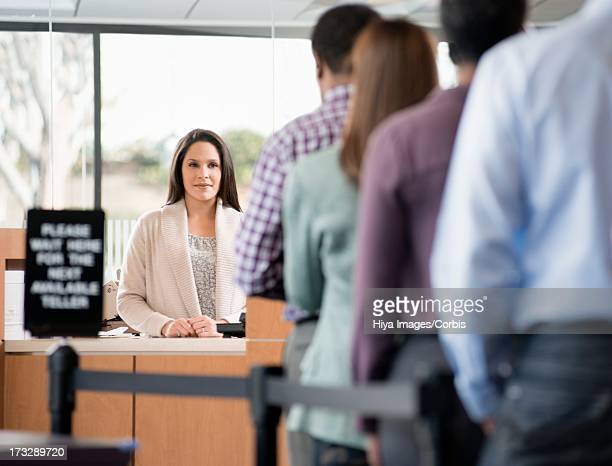 Customers formed in line to bank counter