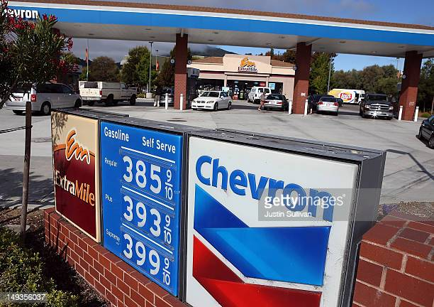 Customers fuel their cars at a Chevron gas station on July 27 2012 in Greenbrae California Chevron reported a 68 percent decline in second quarter...