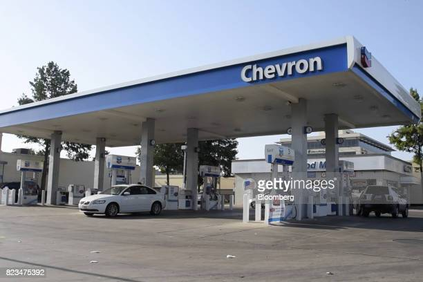 Customers fuel vehicles at a Chevron Corp gas station in Dallas Texas US on Wednesday July 26 2017 Chevron Corp is scheduled to release earnings...