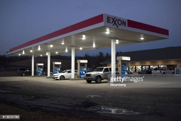 Customers fuel vehicles at an Exxon Mobil Corp gas station in Nashport Ohio US on Friday Jan 26 2018 Exxon Mobil Corp is scheduled to release...