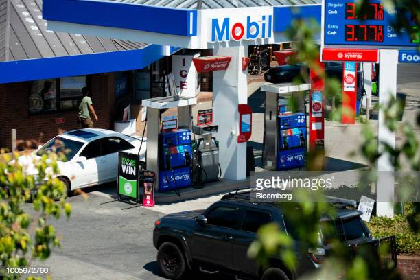 Customers fuel vehicles at an Exxon Mobil Corp gas station in Seattle Washington US on Wednesday July 25 2018 Exxon Mobil Corp is scheduled to...