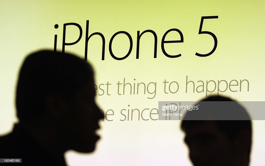 Customers gather to purchase the Apple iPhone 5 inside the Apple Fifth Avenue flagship store on the first morning it went on sale on September 21, 2012 in New York City. Customers lined up for days to purchase the hotly anticipated device which went on sale nationwide today.