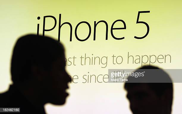 Customers gather to purchase the Apple iPhone 5 inside the Apple Fifth Avenue flagship store on the first morning it went on sale on September 21...