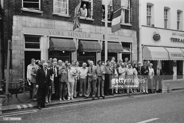 Customers gathering around the York Minster, now known as The French House, pub at 49 Dean Street, Soho, London, UK, 19th July 1979.